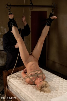 Photo number 8 from Tall long legged blond is hung upside down, made to cum<br>Choked, clamped & abused, left hanging.. shot for Hogtied on Kink.com. Featuring Dylan Ryan in hardcore BDSM & Fetish porn.
