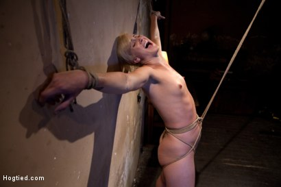 Tall hot blonde on tip-toes hanging from a crotch rope, made to squirt.