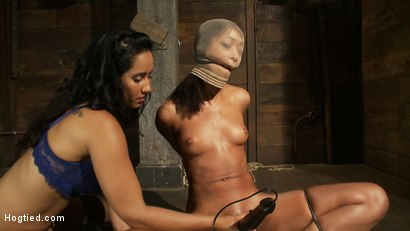 Photo number 7 from Bound with brutal black rubber bands<br>They dig in & constrict, skin is made to squirt & suck cock. shot for Hogtied on Kink.com. Featuring Skin Diamond and Isis Love in hardcore BDSM & Fetish porn.