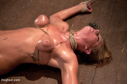 Photo number 10 from 19yr old blond has breasts bound, is oiled, has massive orgasms ripped from her helpless body.  shot for Hogtied on Kink.com. Featuring Lizzy London in hardcore BDSM & Fetish porn.