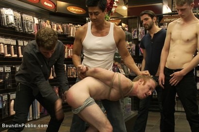 Photo number 4 from Hot Gym Trainer Gets Tied up and Gang Fucked in a Porn Store shot for Bound in Public on Kink.com. Featuring Tristan Jaxx and Alex Summers in hardcore BDSM & Fetish porn.