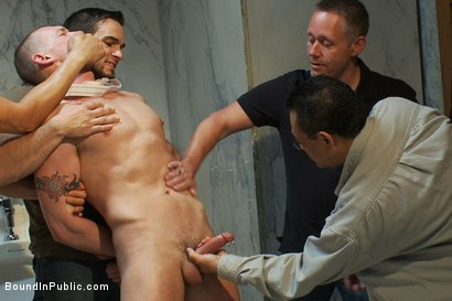 Photo number 6 from The wrestler gets gang banged by a horny crowd in a public restroom for losing his match.      shot for Bound in Public on Kink.com. Featuring Phenix Saint and Kieron Ryan in hardcore BDSM & Fetish porn.