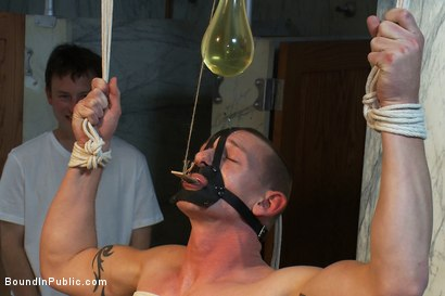 Photo number 3 from The wrestler gets gang banged by a horny crowd in a public restroom for losing his match.      shot for Bound in Public on Kink.com. Featuring Phenix Saint and Kieron Ryan in hardcore BDSM & Fetish porn.