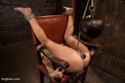 Photo number 12 from Girl next door takes brutal foot caning, devastating orgasms, a horrific throat fucking & anal abuse shot for Hogtied on Kink.com. Featuring Ashli  Orion in hardcore BDSM & Fetish porn.