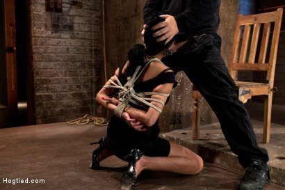 Photo number 1 from Sexy Cougar is bound, and brutally skull fucked  Hair tied on the floor made to cum like a slut! shot for Hogtied on Kink.com. Featuring Beretta James in hardcore BDSM & Fetish porn.
