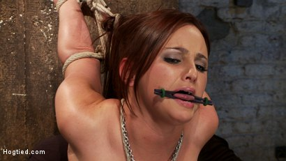 Photo number 6 from Cute 20yr old has elbows tied tight & strappado'd, hair tied back made to cum while totally helpless shot for Hogtied on Kink.com. Featuring Hope Howell in hardcore BDSM & Fetish porn.