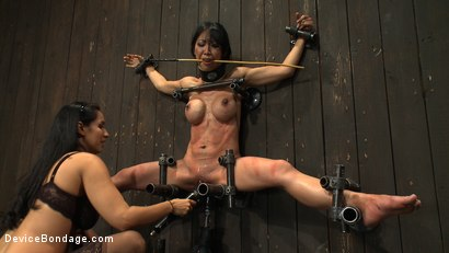 Photo number 11 from Tiny Tia Takes Tenacious Torment  shot for Device Bondage on Kink.com. Featuring Tia Ling and Isis Love in hardcore BDSM & Fetish porn.