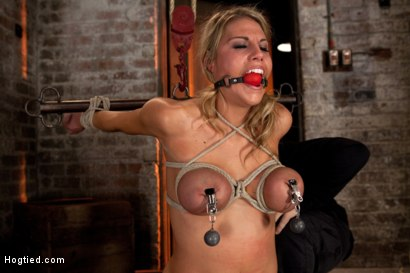 Photo number 7 from State Champion Softball player has her huge tits bound, nipples clamped, brutally skull fucked! shot for Hogtied on Kink.com. Featuring Charisma Cappelli in hardcore BDSM & Fetish porn.