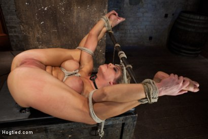 Photo number 14 from Sexy blond bomb shell w/huge tits, is anally penetrated, nipple tortured, made to squirt & cum! shot for Hogtied on Kink.com. Featuring Charisma Cappelli in hardcore BDSM & Fetish porn.