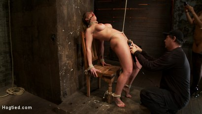 Photo number 11 from Part 1/4 of Decembers live show with Holly heart:<br>A back arching, pussy destroying tie from hell. shot for Hogtied on Kink.com. Featuring Isis Love, Matt Williams and Holly Heart in hardcore BDSM & Fetish porn.