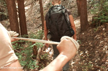 Photo number 1 from Captured straight jock gets his tight ass violated in the deep woods shot for Men On Edge on Kink.com. Featuring Logan Vaughn in hardcore BDSM & Fetish porn.