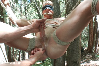 Photo number 11 from Captured straight jock gets his tight ass violated in the deep woods shot for Men On Edge on Kink.com. Featuring Logan Vaughn in hardcore BDSM & Fetish porn.