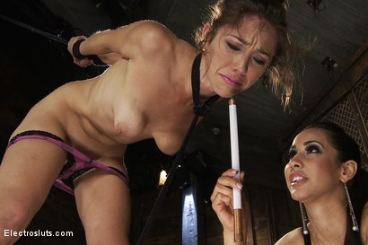 Photo number 12 from Electric Body Used to Power a Light Bulb and Butt Plug shot for electrosluts on Kink.com. Featuring Isis Love and Audrey Rose in hardcore BDSM & Fetish porn.