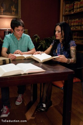 Photo number 1 from Coo Coo ca Choo Foxxy:Seducing a 19yr old in the Library with Her Cock shot for TS Seduction on Kink.com. Featuring TS Foxxy and Matthew in hardcore BDSM & Fetish porn.
