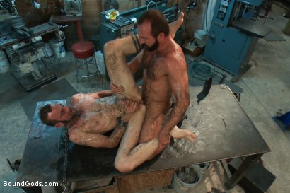 Photo number 13 from Motor oil bondage fuck in the metal shop shot for Bound Gods on Kink.com. Featuring Josh West and Clayton Kent in hardcore BDSM & Fetish porn.