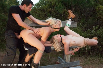 Photo number 12 from Captured in the Woods: A Featured Presentation: Two Beautiful Blondes Brutally Fucked in the Wild shot for Sex And Submission on Kink.com. Featuring James Deen, Penny Pax and Anikka Albrite in hardcore BDSM & Fetish porn.
