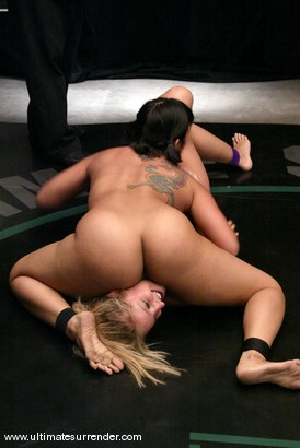 "Photo number 10 from Last season's champion, ""The Dragon"" vs. Hollie ""The Amazon"" shot for Ultimate Surrender on Kink.com. Featuring DragonLily and Hollie Stevens in hardcore BDSM & Fetish porn."