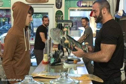 Photo number 1 from Horny crowd jumps on a ripped stud in a skate shop shot for boundinpublic on Kink.com. Featuring Rob Yaeger, Kevin Case and Spencer Reed in hardcore BDSM & Fetish porn.