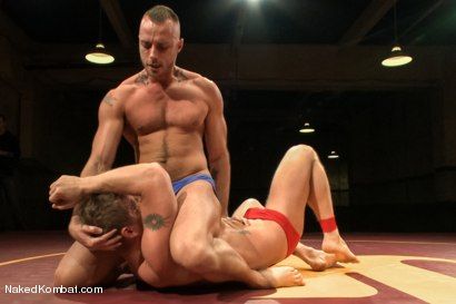 """Photo number 2 from Jessie """"Cut-Throat"""" Colter vs Jeremy """"Stonewall"""" Stevens  <br /> The Muscle Match! shot for Naked Kombat on Kink.com. Featuring Jeremy Stevens and Jessie Colter in hardcore BDSM & Fetish porn."""