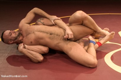 """Photo number 9 from Jessie """"Cut-Throat"""" Colter vs Jeremy """"Stonewall"""" Stevens  <br /> The Muscle Match! shot for Naked Kombat on Kink.com. Featuring Jeremy Stevens and Jessie Colter in hardcore BDSM & Fetish porn."""