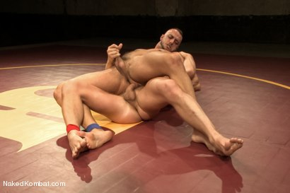 """Photo number 8 from Jessie """"Cut-Throat"""" Colter vs Jeremy """"Stonewall"""" Stevens  <br /> The Muscle Match! shot for Naked Kombat on Kink.com. Featuring Jeremy Stevens and Jessie Colter in hardcore BDSM & Fetish porn."""