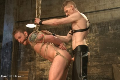 Dockworker gets taken down and fucked by a leather dom