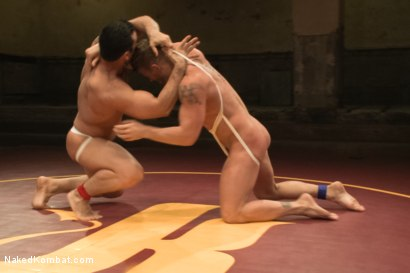 """Photo number 3 from Marcus """"Titan"""" Ruhl vs Jeremy """"Stonewall"""" Stevens - Muscled Oil Match! shot for Naked Kombat on Kink.com. Featuring Marcus Ruhl and Jeremy Stevens in hardcore BDSM & Fetish porn."""