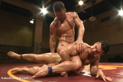 """Photo number 8 from Marcus """"Titan"""" Ruhl vs Jeremy """"Stonewall"""" Stevens - Muscled Oil Match! shot for Naked Kombat on Kink.com. Featuring Marcus Ruhl and Jeremy Stevens in hardcore BDSM & Fetish porn."""