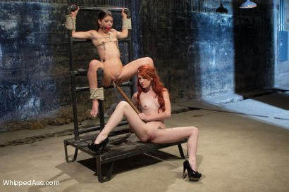 Elle Alexandra, gorgeous redhead dominatrix punishes Mia Gold!