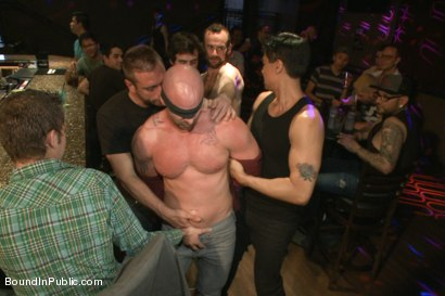 Photo number 1 from Muscle stud Mitch Vaughn tied up and used in a public bar shot for Bound in Public on Kink.com. Featuring Mitch Vaughn, Jeremy Stevens and Rob Yaeger in hardcore BDSM & Fetish porn.
