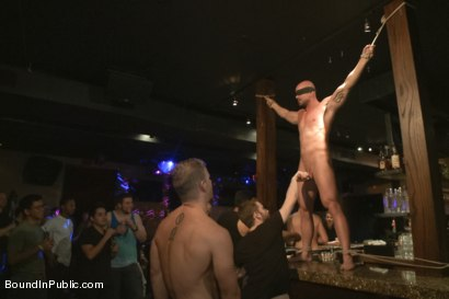 Photo number 6 from Muscle stud Mitch Vaughn tied up and used in a public bar shot for Bound in Public on Kink.com. Featuring Mitch Vaughn, Jeremy Stevens and Rob Yaeger in hardcore BDSM & Fetish porn.