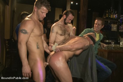 Photo number 13 from Muscle stud Mitch Vaughn tied up and used in a public bar shot for Bound in Public on Kink.com. Featuring Mitch Vaughn, Jeremy Stevens and Rob Yaeger in hardcore BDSM & Fetish porn.