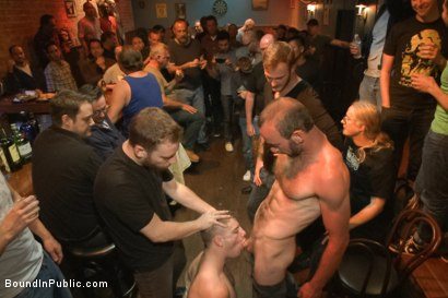Photo number 1 from Ripped stud with a giant cock get used in a crowded bar shot for Bound in Public on Kink.com. Featuring Christian Wilde and Doug Acre in hardcore BDSM & Fetish porn.