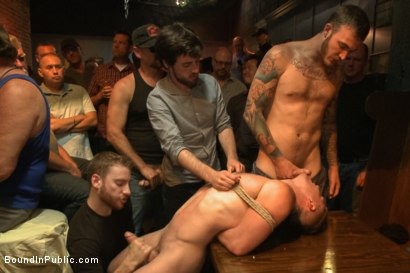 Ripped stud with a giant cock get used in a crowded bar