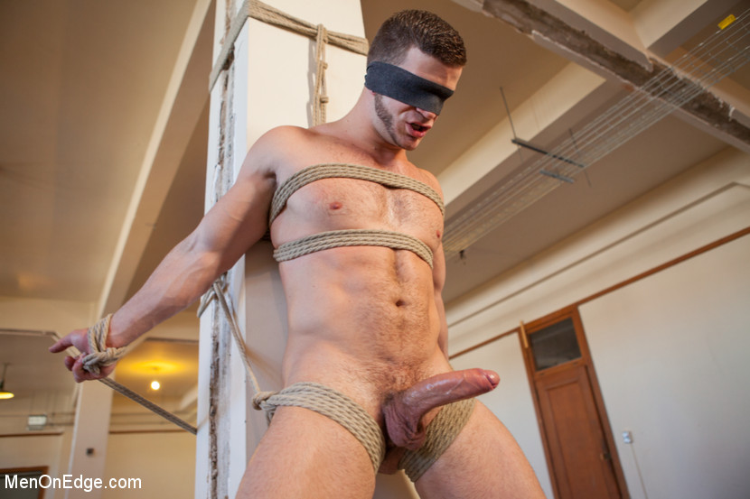 Adult gay suspdended in the air bondage