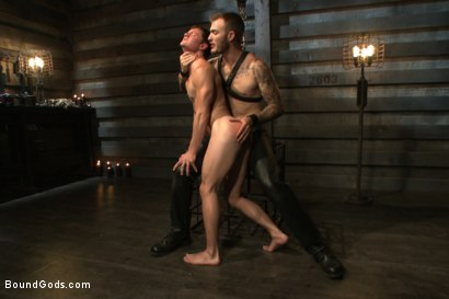 Photo number 4 from Caged sex slave endures a beating, hot wax and hard stockade fuck shot for Bound Gods on Kink.com. Featuring Christian Wilde and Tyler Sweet in hardcore BDSM & Fetish porn.
