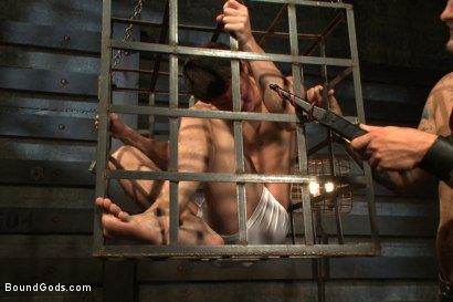 Photo number 2 from Caged sex slave endures a beating, hot wax and hard stockade fuck shot for Bound Gods on Kink.com. Featuring Christian Wilde and Tyler Sweet in hardcore BDSM & Fetish porn.