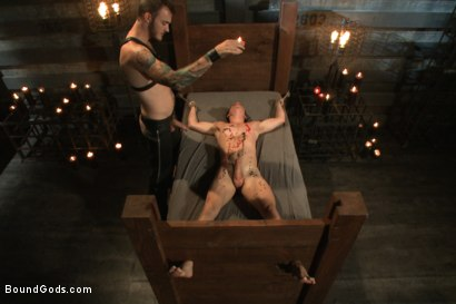 Photo number 9 from Caged sex slave endures a beating, hot wax and hard stockade fuck shot for Bound Gods on Kink.com. Featuring Christian Wilde and Tyler Sweet in hardcore BDSM & Fetish porn.
