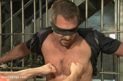 Photo number 2 from Officer Justice taken down and his giant cock edged by two perverts shot for Men On Edge on Kink.com. Featuring Andrew Justice in hardcore BDSM & Fetish porn.