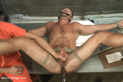 Photo number 9 from Officer Justice taken down and his giant cock edged by two perverts shot for Men On Edge on Kink.com. Featuring Andrew Justice in hardcore BDSM & Fetish porn.