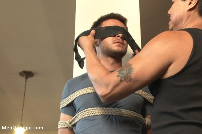 Photo number 1 from Straight stud's huge uncut cock edged by two guys for the first time shot for Men On Edge on Kink.com. Featuring James Riker in hardcore BDSM & Fetish porn.