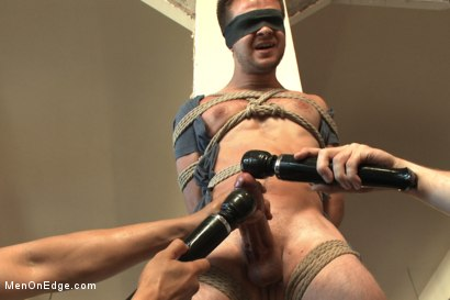 Photo number 5 from Straight stud's huge uncut cock edged by two guys for the first time shot for Men On Edge on Kink.com. Featuring James Riker in hardcore BDSM & Fetish porn.