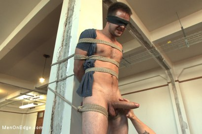 Photo number 3 from Straight stud's huge uncut cock edged by two guys for the first time shot for Men On Edge on Kink.com. Featuring James Riker in hardcore BDSM & Fetish porn.