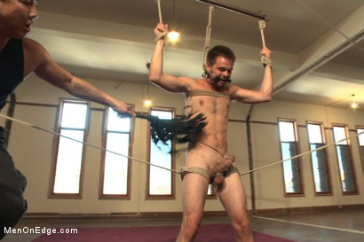Photo number 9 from Straight stud's huge uncut cock edged by two guys for the first time shot for Men On Edge on Kink.com. Featuring James Riker in hardcore BDSM & Fetish porn.