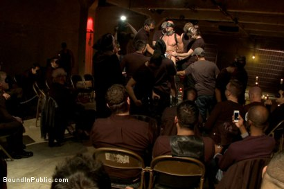 Photo number 14 from Horny Crowd Torments Bound Muscled Stud for BIP's Pre-Halloween Party shot for Bound in Public on Kink.com. Featuring Christian Wilde, Jason Miller, Connor Maguire and Big Red in hardcore BDSM & Fetish porn.