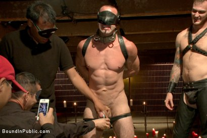 Photo number 15 from Horny Crowd Torments Bound Muscled Stud for BIP's Pre-Halloween Party shot for Bound in Public on Kink.com. Featuring Christian Wilde, Jason Miller, Connor Maguire and Big Red in hardcore BDSM & Fetish porn.