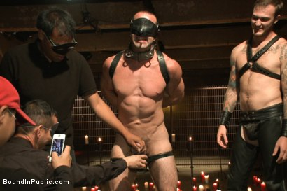 Photo number 3 from Horny Crowd Torments Bound Muscled Stud for BIP's Pre-Halloween Party shot for Bound in Public on Kink.com. Featuring Christian Wilde, Jason Miller, Connor Maguire and Big Red in hardcore BDSM & Fetish porn.