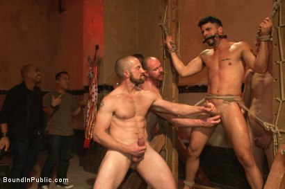 Photo number 4 from Bound hunk with an uncut cock gets gangfucked by a crowd of horny men shot for Bound in Public on Kink.com. Featuring Ray Han, Adam Herst and Big Red in hardcore BDSM & Fetish porn.