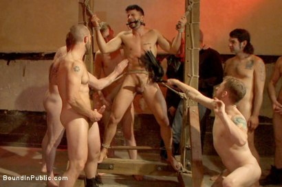 Photo number 3 from Bound hunk with an uncut cock gets gangfucked by a crowd of horny men shot for Bound in Public on Kink.com. Featuring Ray Han, Adam Herst and Big Red in hardcore BDSM & Fetish porn.