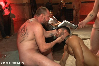 Photo number 8 from Bound hunk with an uncut cock gets gangfucked by a crowd of horny men shot for Bound in Public on Kink.com. Featuring Ray Han, Adam Herst and Big Red in hardcore BDSM & Fetish porn.